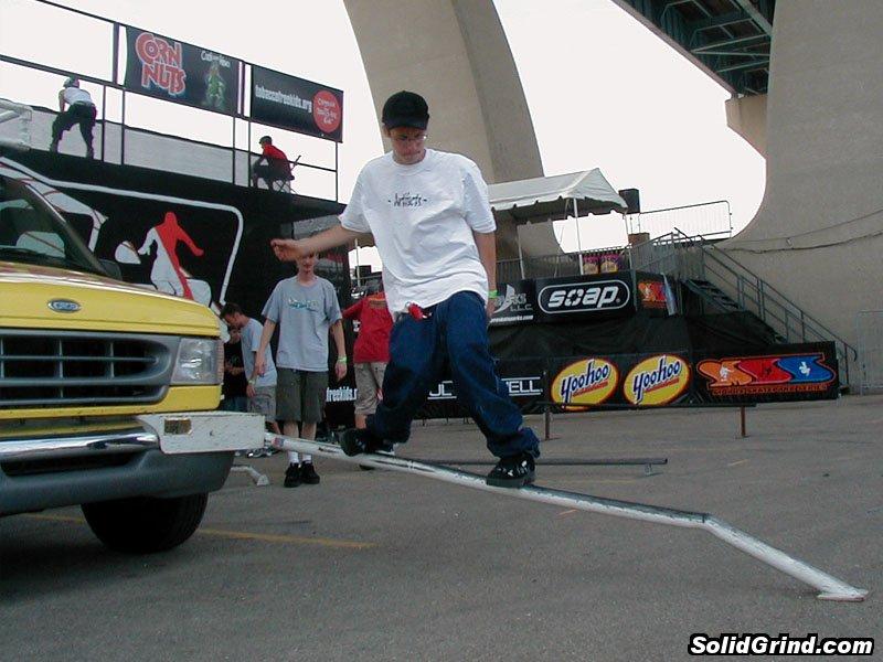 Dude sliding a rail on the Soap Van at the Summer Slam demo