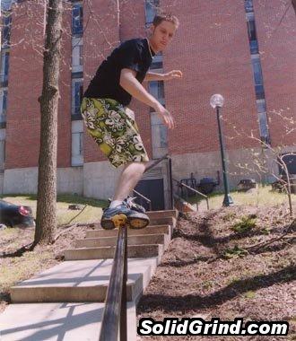 An old school photo of Derek Brooks sliding a handrail at Cornell College