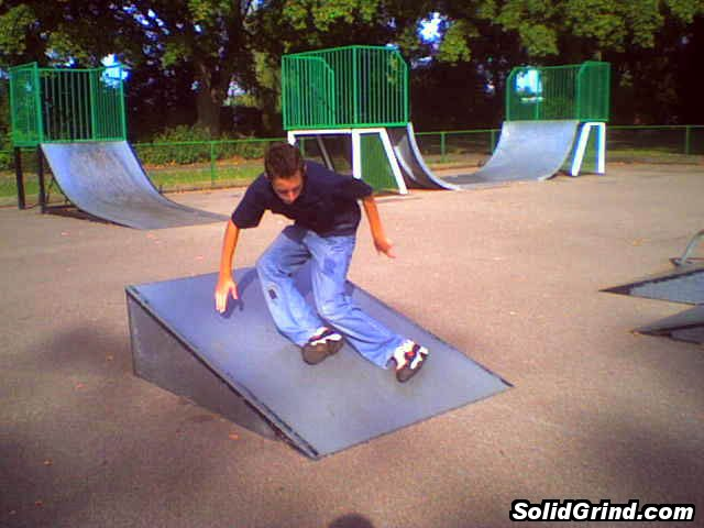 Stuart Pickston with a cess slide down a ramp.