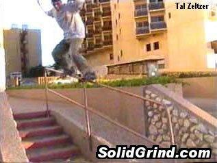 Tal Zeltzer hittin a Grinding a tall handrail