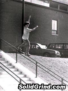 David Plasse sliding a handrail and sportin the afro.