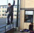 Stuart Pickston hitting a Cheese Grater on the School Gym Rail